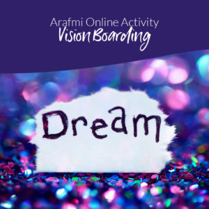 Dream written on paper with glitter with the words Vision Boarding